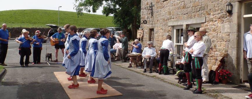 Traditional dancing outside Meg's Cafe, Gilsland