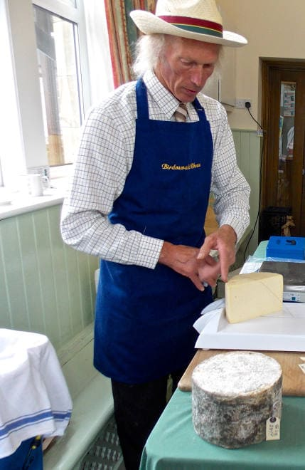 Eric cutting Birdoswald Cheeses at Slack House Farm