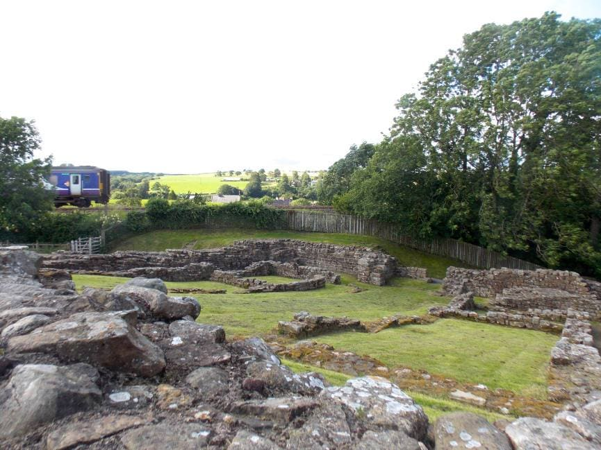 Train passing the Poltross Burn Milecastle on Hadrian's Wall